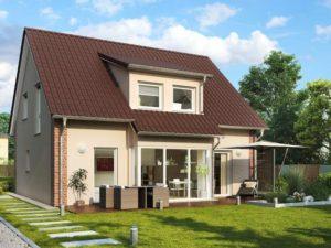 Einfamilienhaus Davos von Helma. Gartenansicht mit Erker