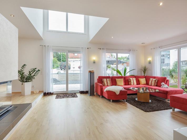 Wohnzimmer im Haus Walmdach 179 von Luxhaus