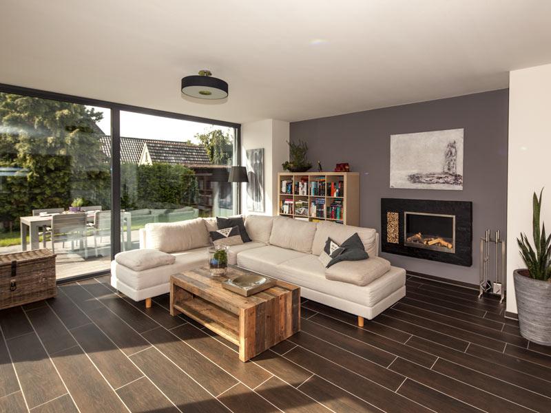Haus Vettel von Baumeisterhaus. Wohnbereich mit Sitzecke