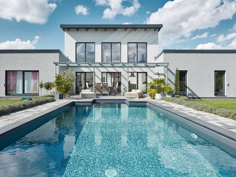 Luxhaus Pultdach Klassik 254 Terrasse Pool