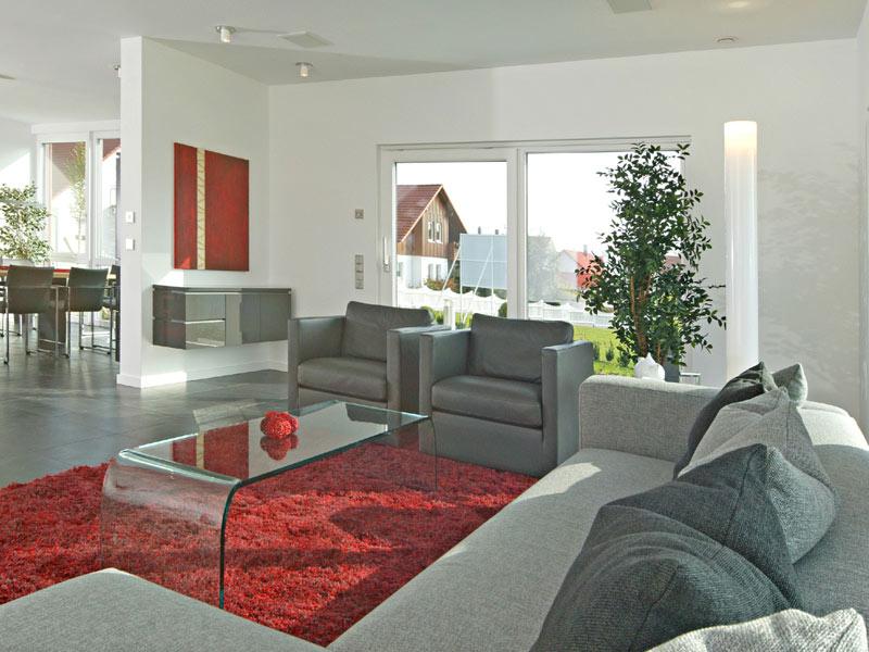 Wohnzimmer im Haus Style von Fertighaus Weiss