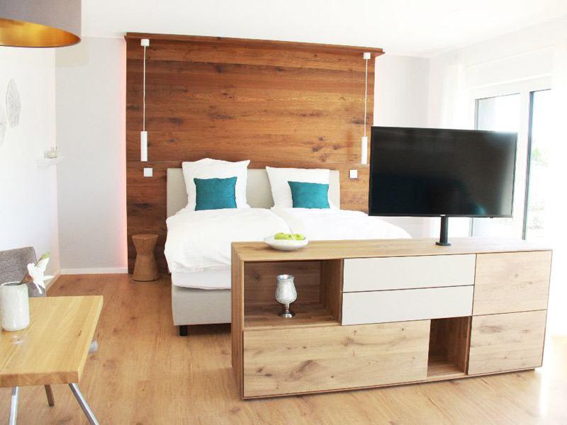 Schlafzimmer im Musterhaus Seegarten von Fischerhaus